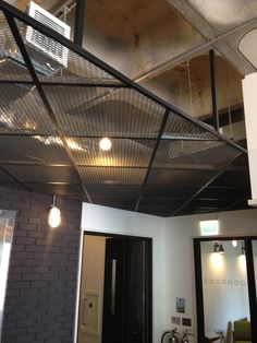 Suspended mesh ceiling, Love this look very nice textures plus industrial feel