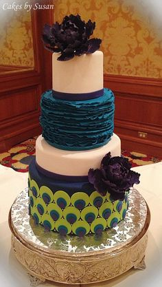 Peacock themed wedding cake with purple sugar peonies
