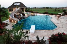 Travertine Geometric Pool with Rock Slide and Grotto traditional pool (Cool Pools With Slides) Swimming Pool Slides, Swimming Pools Backyard, Swimming Pool Designs, Pool With Slide, Lap Pools, Indoor Pools, Backyard Pool Landscaping, Backyard Pool Designs, Landscaping Ideas