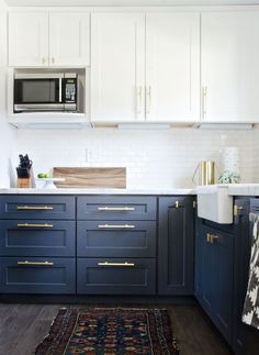 Modern Kitchen Interior Remodeling Navy Brass Modern Kitchen Remodel - The Vintage Rug Shop The Vintage Rug Shop - A kitchen remodel featuring navy cabinetry, brass hardware, and farmhouse accents Two Tone Kitchen Cabinets, Kitchen Redo, Navy Cabinets, Brass Kitchen, Kitchen White, Kitchen Paint, Two Toned Kitchen, Kitchen Backsplash, Grey Cupboards