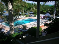 This is a charming, friendly and comfortable 2 Bedroom, 2 Bath condo right in the heart of Olde Naples. Our large pool area has a beautiful heated swimming pool and a hot tub. Poolside tables are available for enjoying ...