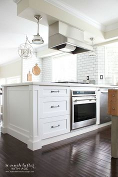 white renovated kitchen / Industrial Vintage French kitchen | somuchbetterwithage.com love the pull out drawers for pots & pans