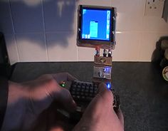 Guy Creates Sick Raspberry Pi Palm Top Computer. Looks like something from a Terry Gilliam film.