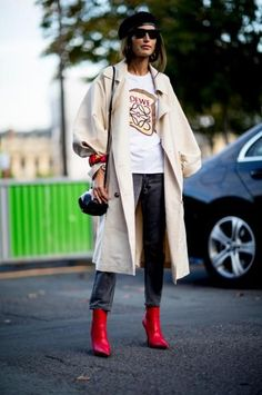 Trench coat, graphic tee, gray jeans, red boots: Best Street Style Looks of PFW Spring 2018