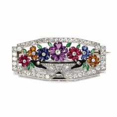 Colored stone and diamond 'jardinière' brooch, circa 1925.  I would sooooo love this in my jewelry box!