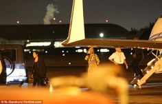 Partied out: Meanwhile Khloe kept it comfortable for the late-night 45 minute flight dress...