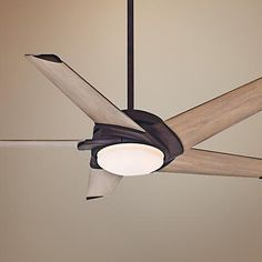 An industrial rust finish paired with river timber finish blades gives this popular Casablanca ceiling fan a rustic look, while LEDs add energy efficiency.