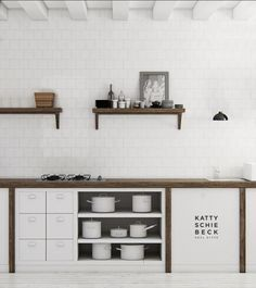 Love the minimalism of the wood mixed with white