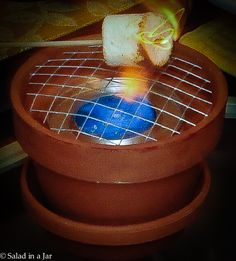 S'mores ..table-top grill with a clay pot, hardware cloth (available at a hardware store by the inch or foot) and a can of Sterno. It's safe to use. Line a few up in a rectangular planter with rocks to make a bar.