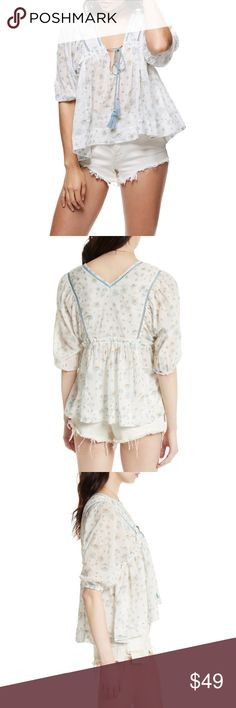 Free People Daisy Print Blouse Details - Split neck with drawstring tie - 3/4 sleeves with elasticized cuffs - Embroidered yoke - Allover print 100% cotton Machine wash Fit: this style fits true to size. Free People Tops Blouses