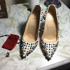 LOUBOUTIN 120mm Gomme Pigalle Pumps 115mm or 4.5 inches high Leather upper with matte lacquered spikes. Point toe. Leather lining. Signature red leather sole Rainbow spikes Padded insole. Made in Italy  Condition: Like new, Worn once.  Comes with extra spikes and hardware from the factory  Item Details Type:Pumps Size:8 Heel Height:Ultra High 4 + Heel Style:Stiletto Brand:Christian Louboutin Color:Multicolor Style/Collection:120mm Gomme Pigalle Pumps With Multicolor Spikes Christian…