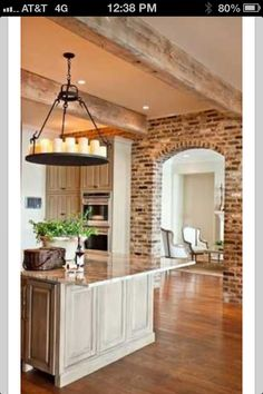 Beautiful kitchen with exposed beams and brick
