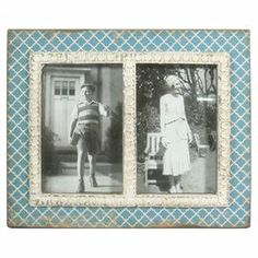 """Display cherished family memories with this vintage-inspired picture frame, showcasing a scales motif and blue finish.  Product: Picture frameConstruction Material: Engineered woodColor: BlueFeatures: Holds two 4"""" x 6"""" photosDimensions: 9"""" H x 11"""" W x 1"""" D"""