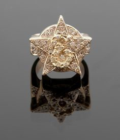"""An Elvis Presley owned 14K yellow gold and diamond """"E"""" ring. Designed as a star topped with a script """"E"""" and entirely set with 47 full-cut round diamonds totaling approximately 2.35 cts. Presley gifted this ring to Charlie Hodge in Las Vegas and joked that Hodge was now the star of the show."""