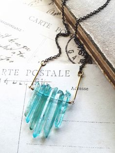 R a i n d r o p s... Raw aqua/ teal crystal dagger necklace by CrowandIris