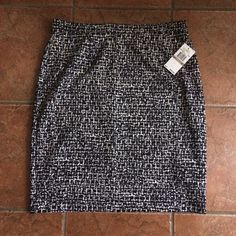 "Michael Kors Black & White Skirt Michael Kors black & white print skirt. Size 12 measures 21"" top to bottom. Fabric is stretchy 5% spandex. New never worn NWT Michael Kors Skirts"