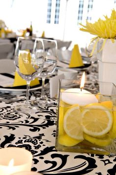 Here's a way to incorporate the lemons to the table in a more modern way...add two of these small candle arrangements to one large BB floral for a full centerpiece look.