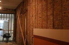 Large sections of the interior brick walls are also now being removed leaving spaces between the studs large enough to pass through.
