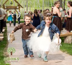 This sweet picture of the flower girl and ring bear was taken by Riley Photography at Dixon's Wedding Venue in Cadott, WI.