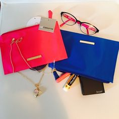 ✨NWT✨Liz Claiborne make up bag+ free goodies! Choose ONE color and I will send it with some surprise goodies (not necessarily what's shown on the pic). Comment on color choice. Save more by bundling! Can be used as a flat wallet too, can hold your phone and essentials. Liz Claiborne Bags Cosmetic Bags & Cases