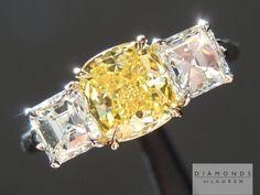 Here is a great example of contrast in a three stone ring. Contrast in the colour between the diamonds - as well as contrast in the cut. 1.18ct Fancy Vivid Yellow VS2 Cushion Cut GIA Center and two 1ct Asscher three stone diamond ring.