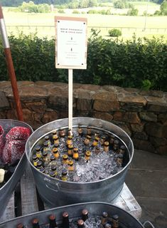 Love this idea of beer bottles iced in tin buckets for the thirstier of our guests