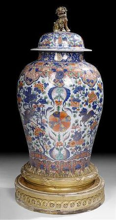 A very large and rare imari-style decorated porcelain vase and cover on French carved gilt-wood stand, China, Kangxi period