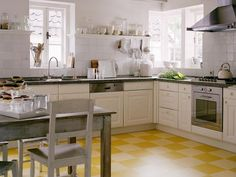 I'm thinking of a yellow floor in the kitchen, and I like linoleum for this 50's house.  SP0820_yellow-checkers_s4x3