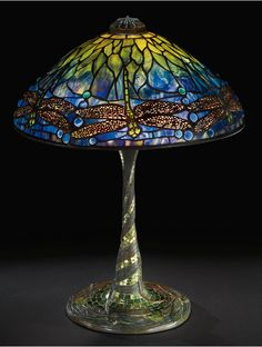 "A SUPERB AND RARE ""DRAGONFLY"" TABLE LAMP  Estimate: 150,000 - 200,000 USD   with a rare favrile mosaic glass ""Dragonfly"" base    leaded glass, favrile mosaic glass and patinated bronze    circa 1905"