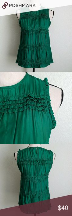 {Theory} 100% silk Kelly green sleeveless top Length -24 inches Chest -16 inches (measured flat)  Please use measurements the only size tag available is a P for petite.  Don't leave this behind. Add it to your bundle ASAP ♡ Photos are the description of this item. Any flaws will be noted.Otherwise article is in excellent condition. Theory Tops