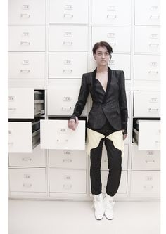 Jacket (wool, silk-screen print, cotton), trousers (wool, silk-screen), shoes (fake leather)