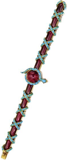 GOLD, GARNET AND TURQUOISE SNAKE BRACELET, CIRCA 1850 Composed of round cabochon and elongated sugarloaf cabochon garnets, accented by small sugarloaf cabochon turquoises, length 7 inches.