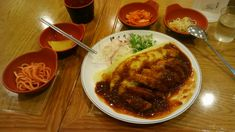Omelet rice with tonkatsu and side dishes Jeju, South Korea