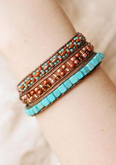 This beaded wrap bracelet would look great with your country or southwestern outfit! This beaded triple wrap bracelet was made by me using metallic brown leather cord with turquoise colored, cube shaped stone beads, and turquoise, copper, and brown colored glass beads. The beads are