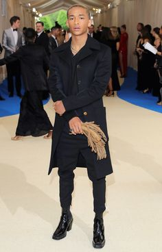 JADEN SMITH carries his newly-shorn hair as a clutch to go with his navy overcoat and shiny boots.