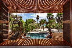 A wood roof  shades numerous places to sit and lounge outside this house, including a jacuzzi near the kitchen overlooks a white sandy beach. Tulum, Riviera Maya, Jacuzzi, House Cast, Camas King, Beachfront House, Storey Homes, Best Sunset, Los Angeles Homes