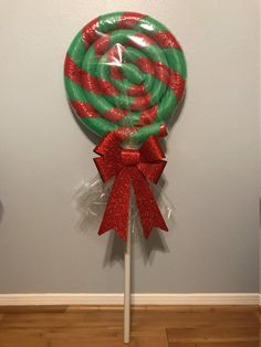 Price includes TWO giant weather resistant lollipops perfect for Christmas decorating or candy land themed parties. Can be used inside or outside. Hand made with durable materials and shrink wrapped f Candy Land Christmas, Whoville Christmas, Christmas Holidays, Christmas Wreaths, Pool Noodle Christmas Wreath, Pool Noodle Wreath, Office Christmas, Pool Noodle Crafts, Indoor Outdoor