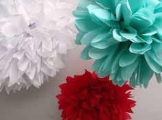 These aqua, red and white pom poms make the perfect finishing touch.  #pompoms #wall #decor