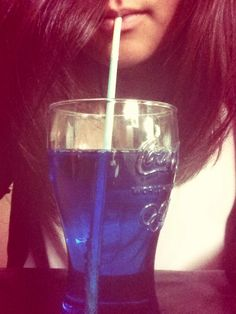 A blue drink with vodka in it.