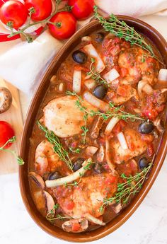 Slow Cooker Chicken Cacciatore with Boneless Skinless Chicken Breasts, Olive Oil, Minced Garlic, Yellow Onion, Mushrooms, Pitted Black Olives, Thyme, Basil, Parsley, Dried Oregano, Red Wine, Diced Tomatoes, Tomato Paste, Red Pepper Flakes.