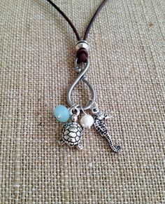 SEA LIFE CHARM Necklace - Leather - You Choose Color - Adjustable - Antique Silver Turtle - SeaHorse Charm, Freshwater Pearl, Glass Dangle by TheCharmingSister on Etsy https://www.etsy.com/listing/184191508/sea-life-charm-necklace-leather-you