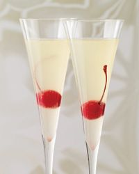 Champagne Cocktails: Platinum Sparkle -   For parties, Kathy Casey premixes the first four ingredients in large batches (3 parts vodka to 1 part each liqueur, Lillet and lemon juice). When she's ready to pour, she fills a shaker with ice and 3 ounces of the mixture, shakes, strains into a glass and tops with Champagne.