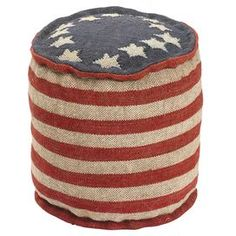 "Accent your living room or home library with this patriotic pouf, featuring a classic stars-and-stripes motif.   Product: PoufConstruction Material: CanvasColor: Red, cream and blueDimensions: 17"" H x 17"" Diameter"