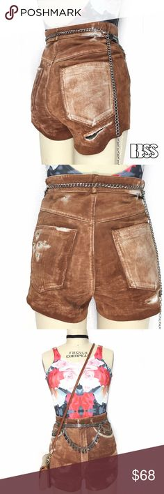 AMAZING VINTAGE REWORKED DISTRESSED LEATHER SHORTS AMAZING VINTAGE REWORKED DISTRESSED LEATHER HIGH WAISTED SHORTS!! 100% LEATHER shorts with distressing and rips all over garment. Sides of shorts have also been scalloped. WAIST: 26' / HIPS: 35' / RISE: 12' Vintage Shorts