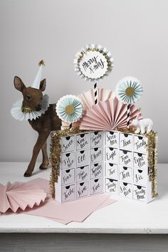 Turn mini chest of drawers into a magical fantasy Christmas calendar with DIY pastel paper fans and glitter. Visit our website for instructions and more DIY inspiration. Christmas Calendar, Advent Calendar, Christmas Diy, Pastel Paper, Paper Fans, Drawers, Glitter, Fantasy, Website