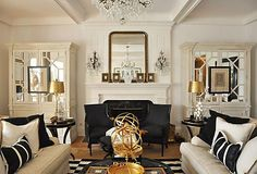 The timelessness of neoclassical design is a given— after all, its graceful silhouettes have stood the test of  centuries. Yet when updated with glimmers of gold,  mirrored furnishings, and a chic black-and-white  palette, the traditional style takes on a glamour that's  utterly of the moment.