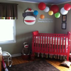 Sock Monkey Nursery...Absolutely love the use of balloons and colorful paper lanterns over this crib! Baby will love looking up at them!