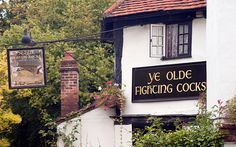 Ye Olde Fighting Cocks, St Albans, Hertfordshire   This unusual, octagonal-shaped pub (it was once a pigeon house) claims to date    all the way back to 973, though historians are sniffy about its claim to be    Britain's oldest - the earliest license date we have for it is from the 18th    century. It's still a charming place to visit, though, with low ceilings,    and even an original bread oven next to one of the fireplaces.