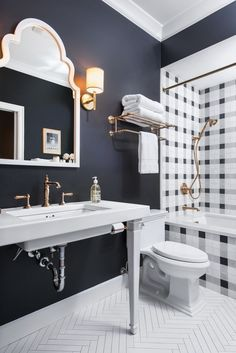 Plaid pattern tile around tub and shower