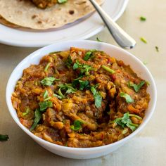 Baingan Bharta Recipe. Restaurant Style Smoked eggplant curry recipe. Eggplants roasted in stove and made into a spicy curry. With step by step pictures.